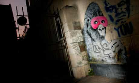 banksy gorilla in pink mask SWNS