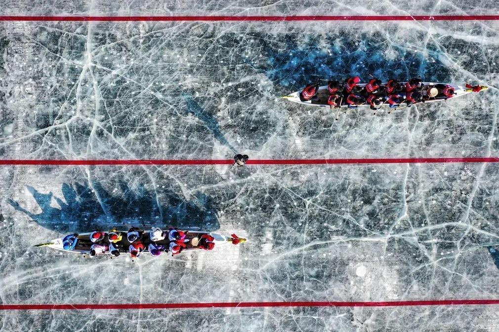 kina jegsarkany verseny sport fagyott folyo nap fotoja